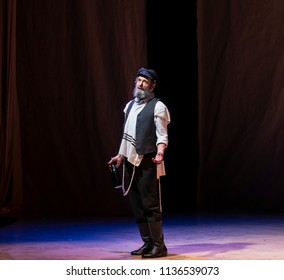 New York, NY - July 15, 2018: Steven Skybell as Tevye performs during premiere of musical Fiddler on the Roof in Yiddish at Museum of Jewish Heritage