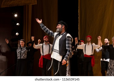 New York, NY - July 15, 2018: Steven Skybell played role Tevye addresses audience during premiere of musical Fiddler on the Roof in Yiddish at Museum of Jewish Heritage