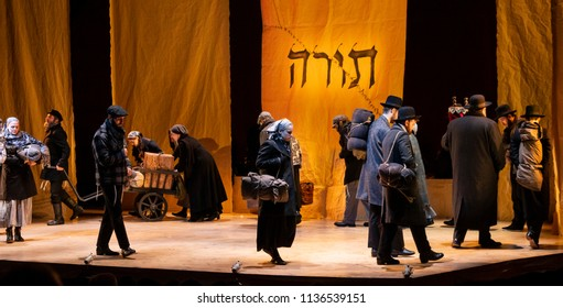 New York, NY - July 15, 2018: Final scene as seen during premiere of musical Fiddler on the Roof in Yiddish at Museum of Jewish Heritage by National Yiddish Theatre Folksbiene