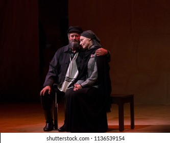 New York, NY - July 15, 2018: Steven Skybell as Tevye & Mary Illes as Golde perform during premiere of musical Fiddler on the Roof in Yiddish at Museum of Jewish Heritage