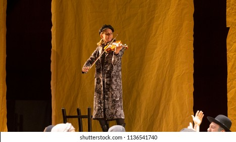 New York, NY - July 15, 2018: Lauren Jeanne Thomas as Der Fiddler performs during premiere of musical Fiddler on the Roof in Yiddish at Museum of Jewish Heritage