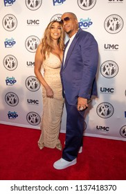 New York, NY - July 18, 2018: Wendy Williams wearing dress by Norma Kamali and Kevin Hunter attend Wendy Williams and The Hunter Foundation gala at Hammerstein Ballroom