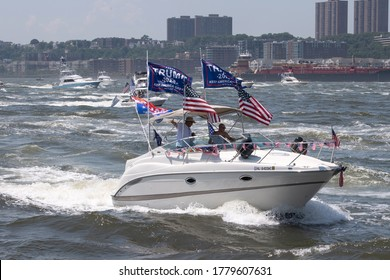 """NEW YORK, NY - JULY 19, 2020: A huge flotilla of President Trump supporter's boats and jetski displaying Trump 2020 flags part of """"TrumpStock"""" events makes it way up Manhattan's Hudson River."""