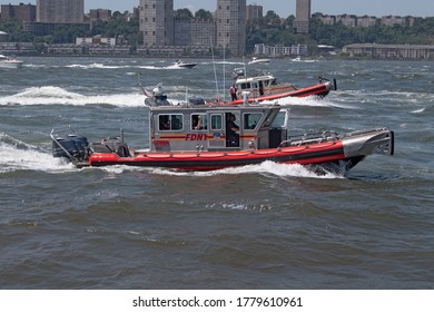 NEW YORK, NY - JULY 19: FDNY scuba boats escort a flotilla of President Trump supporter's boats and jetski making their way up the Hudson River on July 19, 2020 in New York City.