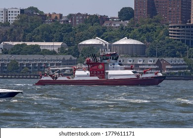 NEW YORK, NY - JULY 19: FDNY boat Three Forty Three escorts a flotilla of President Trump supporter's boats and jetski making their way up the Hudson River on July 19, 2020 in New York City.