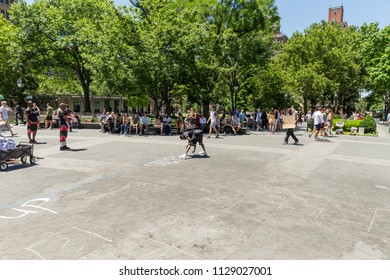 New York, NY - July 7, 2018: New Yorkers enjoy pleasant summer weekend at Washington Square Park