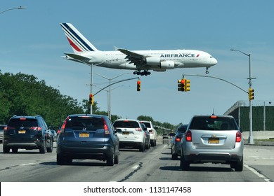 NEW YORK, NY - JULY 7, 2018: Traffic Light Flyover. An Air France Airbus A380 landing at JFK International Airport in NYC.