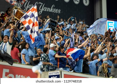 New York, NY - July 8, 2018: Fans of NYCFC celebrate goal by Maxi Moralez (not pictured) during MLS regular game against New York Red Bulls at Yankee Stadium NYCFC won 1 - 0