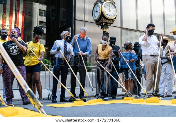 New York, NY - July 9, 2020: De Blasio, Al Sharpton & volunteers paint Black Lives Matter mural on 5th Avenue in front of Trump Tower