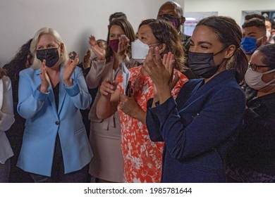 NEW YORK, NY - JUNE 04: Senator Gillibrand, Representative Meng and Representative Ocasio-Cortez clap for healthcare workers at Elmhurst Hospital in Queens on June 4, 2021 in New York City.