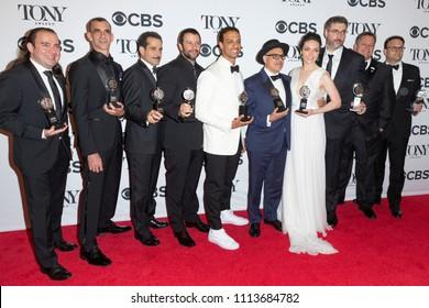 New York, NY - June 10, 2018: Award winners Tony Shalhoub, Ari'el Stachel, David Yazbek, Katrina Lenk & cast & crew of The Band's Visit pose in 72nd Annual Tony Awards Media Room at 3 West Club
