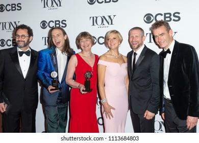 New York, NY - June 10, 2018: Award winners Tony Kushner, Jordan Roth, Rowan Ian Seamus Magee, Lisa Burger, Rufus Norris pose in 72nd Annual Tony Awards Media Room at 3 West Club