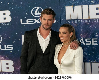 New York, NY - June 11, 2019: Chris Hemsworth in Dolce & Gabbana suit and Elsa Pataky attend Men in Black: International premiere at AMC Lincoln Center