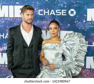 New York, NY - June 11, 2019: Chris Hemsworth in Dolce & Gabbana suit and Tessa Thompson wearing dress by Rodarte attend Men in Black: International premiere at AMC Lincoln Center