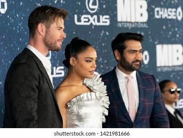New York, NY - June 11, 2019: Chris Hemsworth in Dolce & Gabbana suit, Tessa Thompson wearing dress by Rodarte, Kumail Nanjiani attend Men in Black: International premiere at AMC Lincoln Center