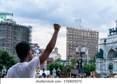 New York, NY - June 19, 2020: Jon Batiste raises clenched hand at the 'We Are: a Voter Registration' recital during Juneteenth celebration at Brooklyn Public Library at the Grand Army Plaza