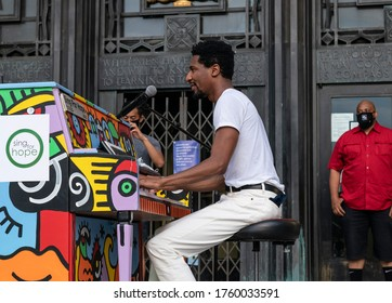 New York, NY - June 19, 2020: Jon Batiste performs at the 'We Are: a Voter Registration' recital during Juneteenth celebration at Brooklyn Public Library at the Grand Army Plaza