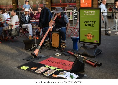 New York, NY June 2019: Taste of Times Square: a didgeridoo and percussion artist  performing while people eat