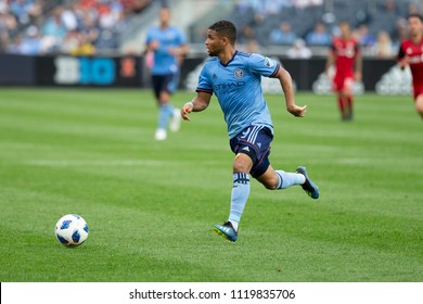 New York, NY - June 24, 2018: Ismael Tajouri-Shradi (29) of NYCFC controls ball during regular MLS game against Toronto FC at Yankee stadium NYCFC won 2 - 1