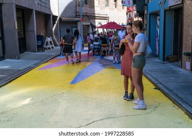 New York, NY - June 25, 2021: Historic Doyers Street in Chinatown covered with colorful mural entitled Rice Terraces by artist Dasic Fernandez