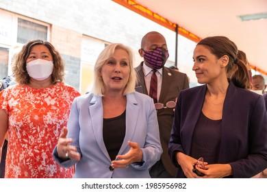 New York, NY - June 4, 2021: Representative Grace Meng, Senator Kirsten Gillibrand, Representative Alexandria Ocasio-Cortez and other elected officials meet with employees at Elmhurst hospital