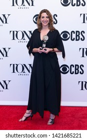 New York, NY - June 9, 2019: Eva Price poses with Tony award at media room of the 73rd annual Tony Awards at Radio City Music Hall