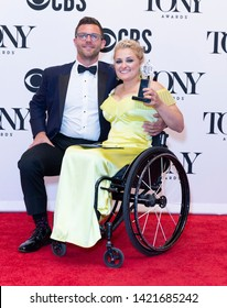 New York, NY - June 9, 2019: David Perlow and Ali Stroker with Tony award for best performance as actress in musical pose at media room of 73rd annual Tony Awards at Radio City Music Hall