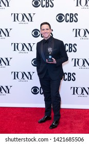 New York, NY - June 9, 2019: Santino Fontana with Tony award poses in media room at the 73rd annual Tony Awards at Radio City Music Hall