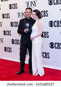 New York, NY - June 9, 2019: Santino Fontana with Tony award and Jessica Hershberg pose in media room at the 73rd annual Tony Awards at Radio City Music Hall