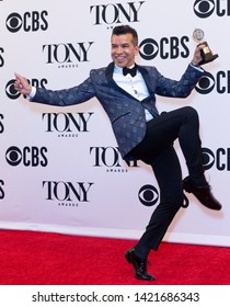 New York, NY - June 9, 2019: Sergio Trujillo poses with Tony award at media room of the 73rd annual Tony Awards at Radio City Music Hall