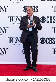 New York, NY - June 9, 2019: Robert Horn poses with Tony award at media room of the 73rd annual Tony Awards at Radio City Music Hall