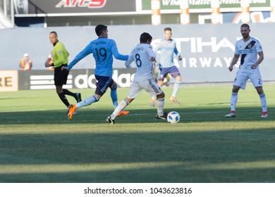 New York, NY - March 11, 2018: Jonathan Dos Santos (8) of LA Galaxy controls ball during regular MLS game against NYC FC at Yankee stadium NYC FC won 2 - 1