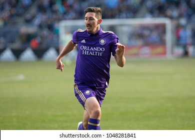 New York, NY - March 17, 2018: Sacha Kljestan (16) of Orlando City SC chases ball during regular MLS game against NYC FC at Yankee stadium NYC FC won 2 - 0