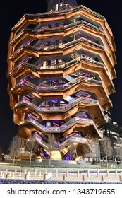 """NEW YORK, NY - MARCH 19, 2019: """"The Vessel"""" Sculpture Structure in Hudson Yards is 16 stories high with 155 stairs. Tall view."""