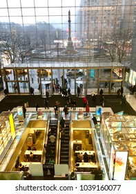 NEW YORK, NY - MARCH 2, 2018: Interior of the Shops at Columbus Circle shopping center at Time Warner Center in New York, NY with a view to the statue of Columbus in the background.