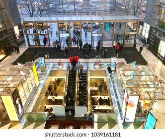 NEW YORK, NY - MARCH 2, 2018: Shoppers and visitors inside the Shops at Columbus Circle shopping center at Time Warner Center in New York, NY.