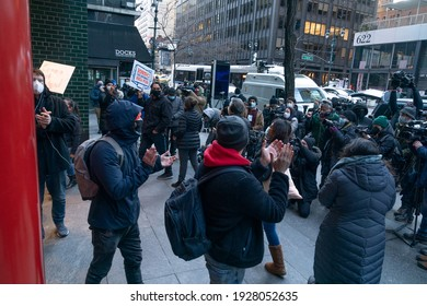 New York, NY - March 2, 2021: Small group of protesters are calling for Governor Cuomo's resignation following a series of sexual harassment accusations at 633 3rd avenue