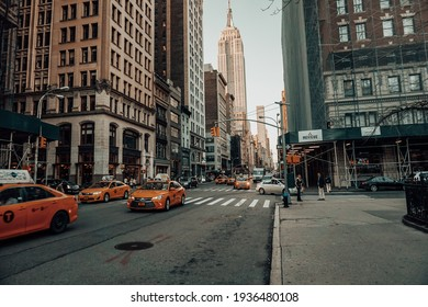 NEW YORK, NY - MARCH 2, 2021: Yellow Cab in a street of New York City with the Empire sate building