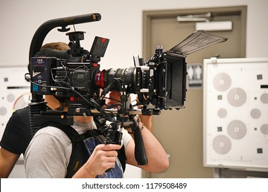 New York, NY; March 2018: Two cameramen prep a RED Digital Cinema camera for an upcoming shoot