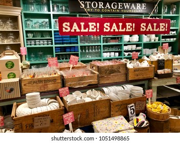 NEW YORK, NY - MARCH 21, 2018: Dinnerware, glassware and dishes displayed in wooden boxes for sale in a store.