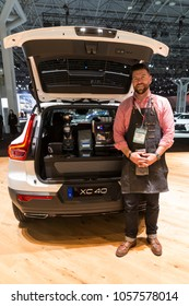 New York, NY - March 28, 2018: Joshua Boyt of Advanced Placement demonstrate coffee machine built into Volvo XC40 at 2018 New York International Auto Show at Jacob Javits Center