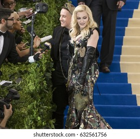NEW YORK, NY - MAY 01, 2017: Jeremy Scott and Madonna attend the 'Rei Kawakubo/Comme des Garcons: Art Of The In-Between' Costume Institute Gala at Metropolitan Museum of Art