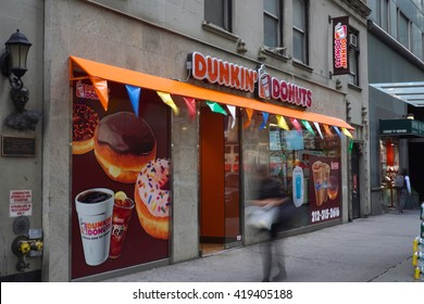 New York, NY - May 10, 2016: Establishing shot of a Dunkin Donuts midtown Manhattan location serving coffee and breakfast to commuters