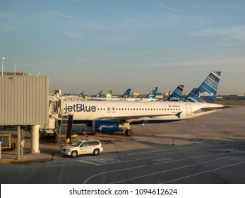 NEW YORK, NY – May 11, 2018: Fleet of JetBlue airliners waiting for refuel at JFK Airport