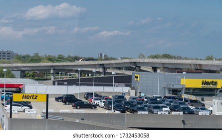 New York, NY - May 15, 2020: Car rental Hertz parking lot is full since there are no customers during COVID-19 pandemic at JFK airport