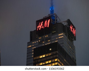 NEW YORK, NY – MAY 16, 2018: 4 Times Square building with H&M sign looming high on a rainy day