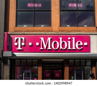 New York, NY - May 17, 2019: Exterior of T-Mobile store with logo, Brooklyn, NY. T-Mobile is one of the biggest multinational telecommunication company.