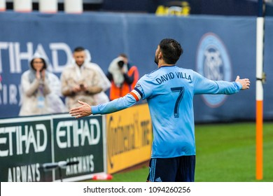 New York, NY - May 19, 2018: David Villa (7) of NYCFC celebrates after scoring his 2nd goal during regular MLS game against Colorado Rapids at Yankee stadium held under rain NYCFC won 4 - 0