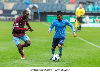 New York, NY - May 19, 2018: Maximiliano Moralez (10) of NYCFC controls ball during regular MLS game against Colorado Rapids at Yankee stadium held under rain NYCFC won 4 - 0