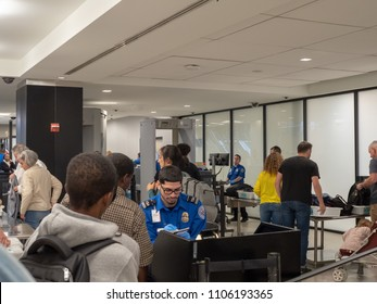 NEW YORK, NY – MAY 19, 2018: Travelers lining up at a Transportation Security Administration (TSA) queue in JFK airport in New York City.